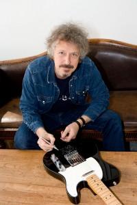 Wolfgang Niedecken signs SchoolJam charity guitar
